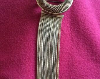 Vintage gold tone circular mesh brooch with hanging fringe - c1970s