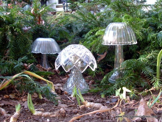 Garden art--a trio of glass mushrooms.  Made with re-purposed upcycled glass so they won't go bad.