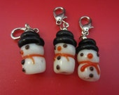 A set of 3 glass lampwork snowman stitch markers for knitting and crochet - with lobster clasps