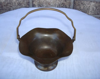 """Solid Brass Basket Dish with Movable Handle. 5.5"""" tall.  Good Condition.  Needs polishing."""