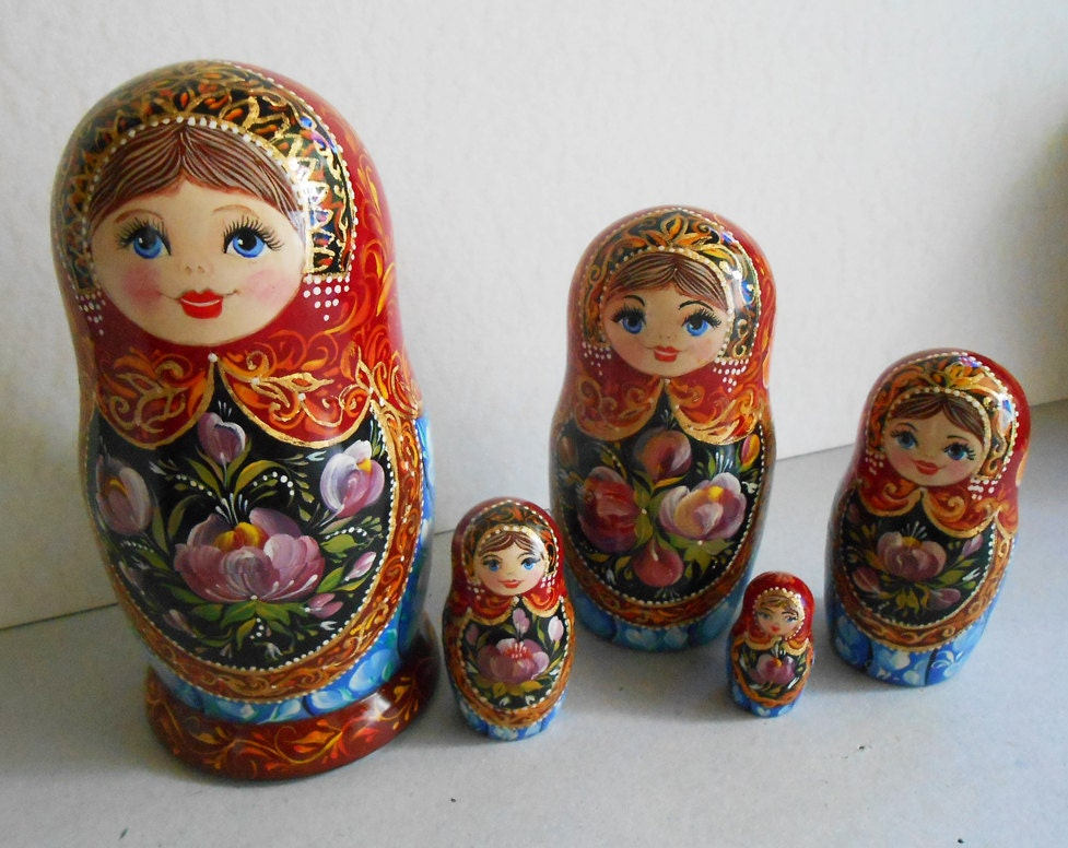 nesting dolls matryoshka with painting in russian style