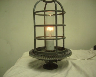 A caged light standing on a pedistal