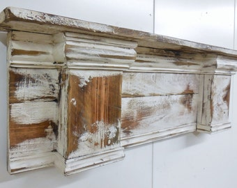 Hello and thank you for stopping by. Introducing my upscale French country mantle. This one has a ton of detail including an arched bottom. Wooden appliques add a very French charm. This mantle is done in my distressed white. This one starts at 24 inches