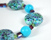 Turquoise beaded bracelet Lampwork glass and purple Swarovski crystal Colorful beaded jewelry.