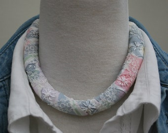 Pastel Necklace - pink and grey fabric strips with lace bound round fleece inner embroidered with daisies