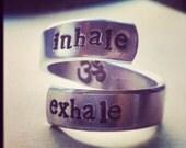 Inhale exhale ring om symbol inside