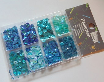 1 package of 8 different blue tone sequins, 7 mm (HR14)
