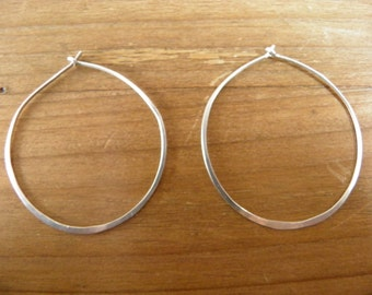 "Earrings... ""Running in Circles"" earrings are beautiful light sterling silver hoops."