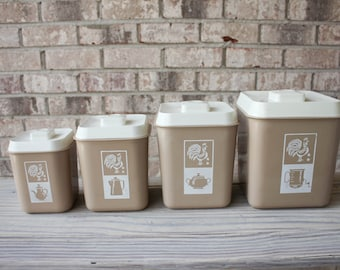 Mid century mauve and white graphic imagery kitchen canisters flour sugar coffee tea