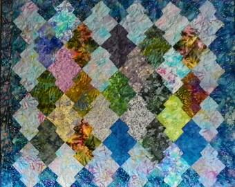 "Multicolor batik lap quilt named ""Dragon's Jewels"""