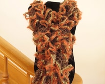 Blow out Sale! Crocheted Orange and brown ruffle scarf with orange fuzzy mohair like edges and a gold metallic accent.
