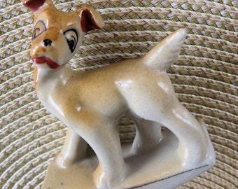 vintage japan ceramic rocking dog figurine