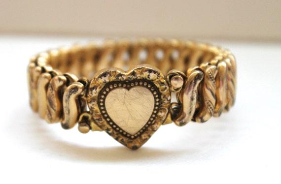 Vintage Gold Filled Sweetheart Bracelet Circa 1940's. Jasper Bracelet. Beveled Rings. Lotus Engagement Rings. Heart Shaped Wedding Rings. Multi Color Sapphire. Moissanite Pendant. Solid Gold Lockets. Diamond Eternity Bracelet