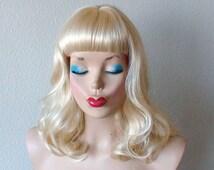 Blonde wig. Vintage hairstyle Pure blonde color Short bangs Shoulder length  wavy/ curly hair wig.