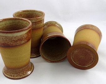 Set of four tan tumblers