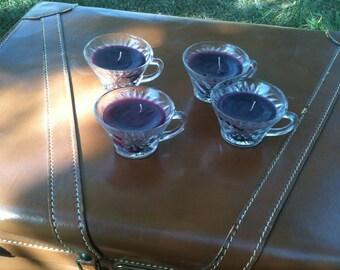 Set of four purple teacup candles