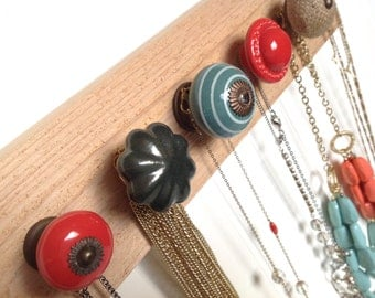 Festive Red and Teal Knobs on Cedar #613