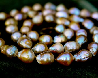 golden baroque pearl long necklace closed with a hand-carved jade clasp