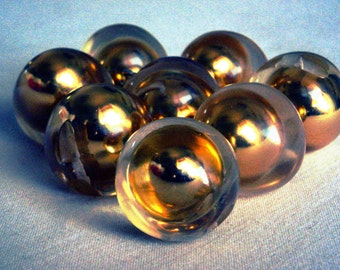 spherical plastic buttons with golden detail