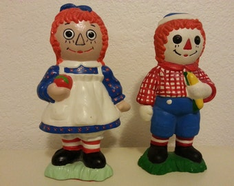 Ceramic Raggedy Ann and Andy Figurines sold as a set