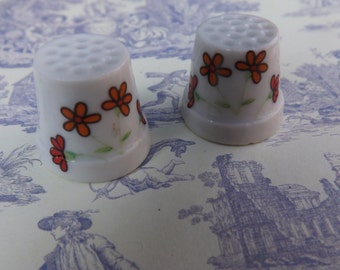 Duo of matching vintage thimbles