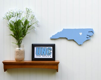 "North Carolina Tarheels ""State Heart"" wall art, handcrafted wood featuring official team colors"