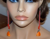 Extra Long Orange Chainmaille Earrings with Orange Feathers.