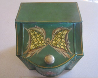 Tole tin canister or hod.  Designed to hold coal for a small coal stove, probably in a bedroom, in the Victorian time