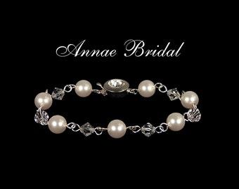 "Bridal jewelry, wedding, White pearl and crystal bracelet, Swarovski, silver ""Sweet Kiss"" bracelet"