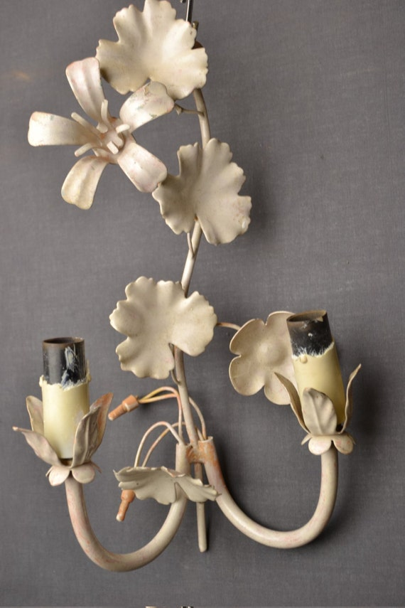 White Itailian tole sconce with flowers.