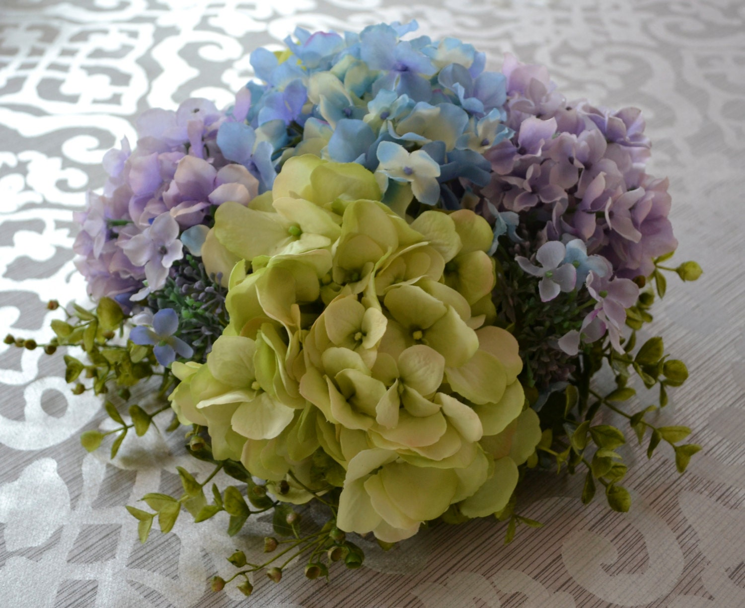 Purple blue and green hydrangea floral centerpiece baby