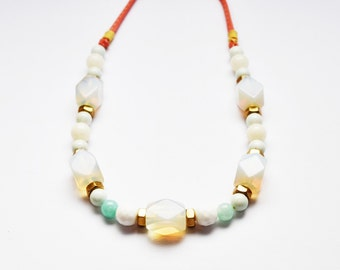 Moonstone and jade beaded necklace with brass nuts and Liberty of London soft cotton fabric. Handmade studio jewellery for women