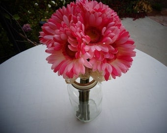 Toss bouquet for the bride in pink gerber daisies