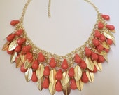 Coral drop necklace  Gold feathers and Rhinestone Necklace