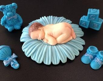 Fondant baby boy on blue daisy cake topper for Baby Shower, Birthday
