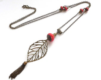 Long pendant necklace, bronze jewelry, long pompom pendant, red beaded necklace