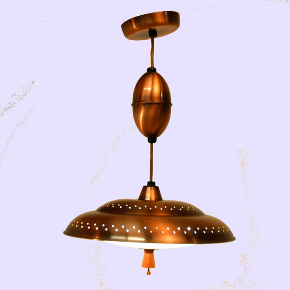 Vintage 1950s Copper Flying Saucer Retractable By
