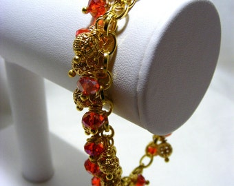 Gold and Red Charm Bracelet