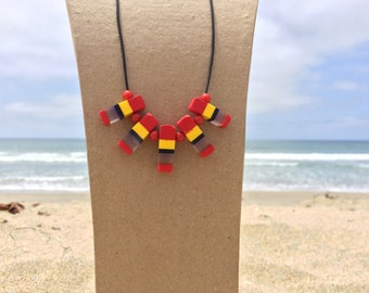 Red, Yellow & Black Handcrafted Surfboard Resin Necklace