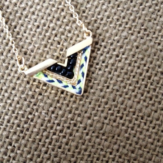v shaped necklace with thread and black seed