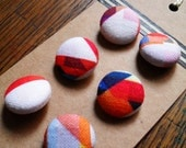 Six unique handmade fabric covered buttons, colourful geometric retro design digitally printed onto cotton.