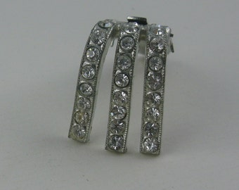 Age old, elegant clothes clip / clothing clip made made of silver metal with rhinestones. Vintage