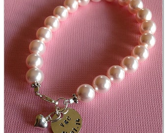 Swarovski 8mm pearl bracelet with sterling silver charms.