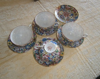 Four Chinese Eggshell Teacups and Saucers,One Extra Saucer, Hand Painted,Decorated in Hong Kong
