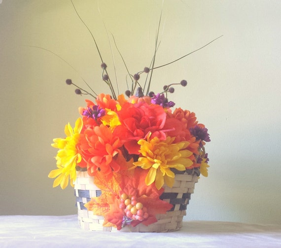 Fall floral arrangement in basket with pumpkinautumn