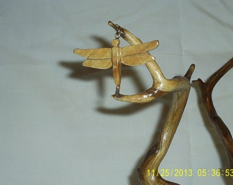 A Dragonfly pendant made from maple wood apox. 2in. wide. Free shipping