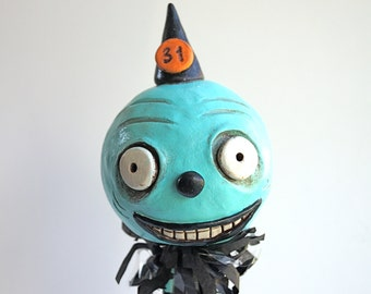 Turquoise Creepy Face Halloween Folk Art Sculpture made from Polymer Clay as seen in Holiday's and Celebrations Magazine