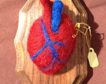 "Small needle felted ""taxidermy"" hearts"