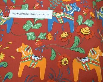 Scandinavian Swedish Dala Horses & Flowers on Brick Red Fabric