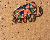 Brand new Gramatik Lowtemp solo Mammoth pins!  Orange and Purple Mammoth!